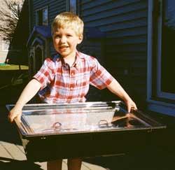 Child holding Solar Oven